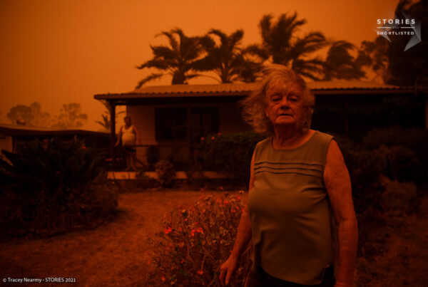 Nancy Allen and Brian Allen use garden hoses to wet down the house as high winds push smoke and ash from the Currowan Fire towards Nowra, Australia December 26, 2019.150 fires are burning across NSW as Australia experiences an unprecedented fire season. The fires are causing their own weather system with thunder clearly audible as the Currowan fire approached. REUTERS/Tracey Nearmy