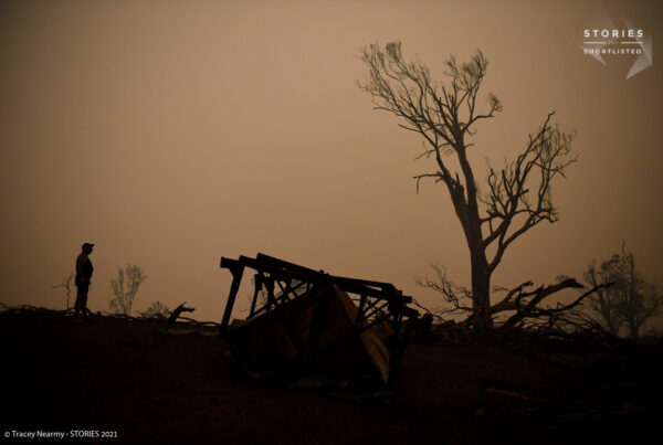 Cobargo resident John Aish walks through a destroyed home in Cobargo, Australia January 5, 2020. REUTERS/Tracey Nearmy